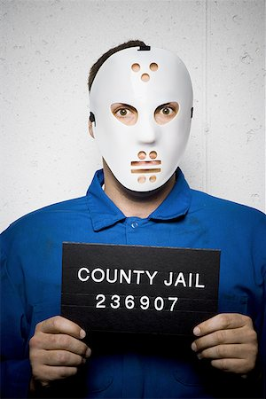 Mug shot of man with hockey mask Stock Photo - Premium Royalty-Free, Code: 640-01355601