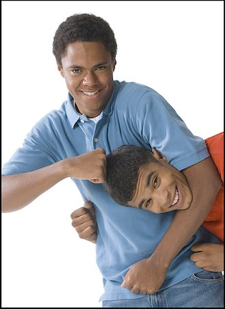 Portrait of two young men horsing around Stock Photo - Premium Royalty-Free, Code: 640-01355625
