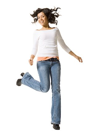 Portrait of a teenage girl jumping Stock Photo - Premium Royalty-Free, Code: 640-01355659