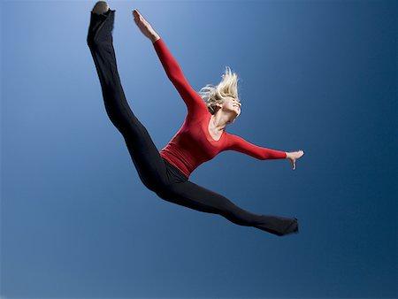 Woman jumping Stock Photo - Premium Royalty-Free, Code: 640-01355703