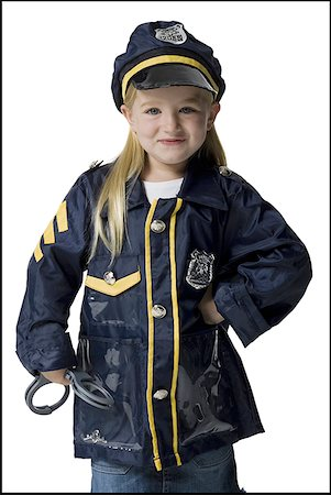 female police officer happy - Portrait of a girl dressed as a police officer Stock Photo - Premium Royalty-Free, Code: 640-01355723