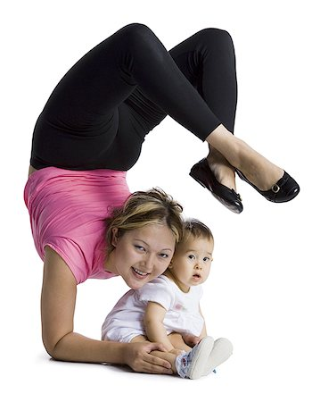 Contortionist mother with baby daughter Stock Photo - Premium Royalty-Free, Code: 640-01355827