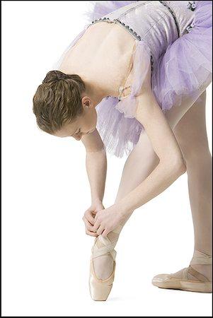 Ballerina tying her slipper Stock Photo - Premium Royalty-Free, Code: 640-01355849
