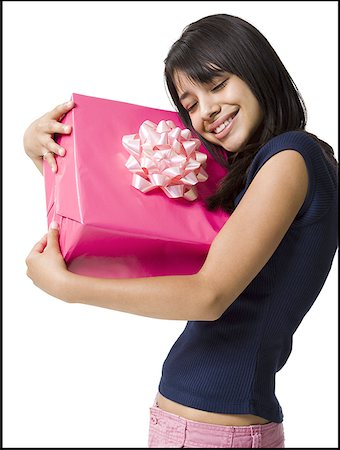 Close-up of a teenage girl holding a gift Stock Photo - Premium Royalty-Free, Code: 640-01355904