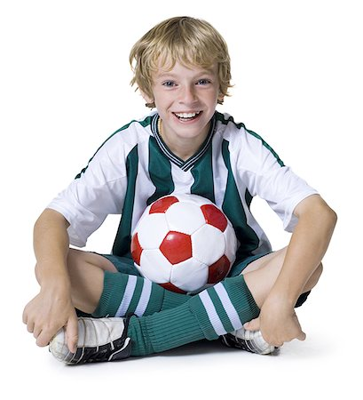 preteen  smile  one  alone - Portrait of a boy sitting with a soccer ball Stock Photo - Premium Royalty-Free, Code: 640-01356320