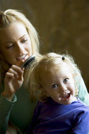 Mother brushing her daughter's hair Stock Photo - Premium Royalty-Free, Code: 640-01356400