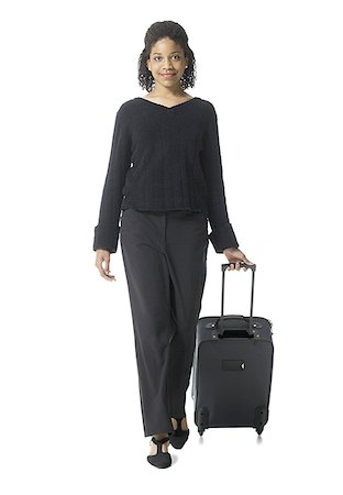 Portrait of a teenage girl walking with luggage Stock Photo - Premium Royalty-Free, Code: 640-01356424