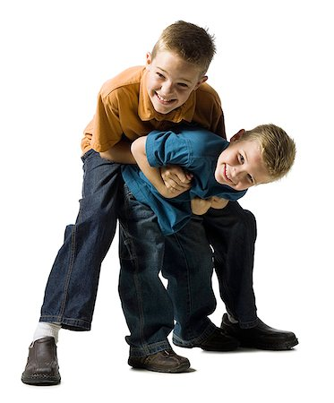 Two brothers wrestling and play fighting Stock Photo - Premium Royalty-Free, Code: 640-01356569