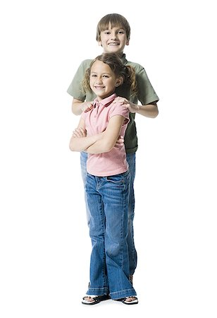 preteen thong - Portrait of a boy standing with his sister Stock Photo - Premium Royalty-Free, Code: 640-01356602
