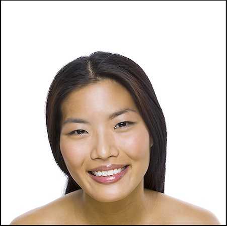 Portrait of a woman smiling Stock Photo - Premium Royalty-Free, Code: 640-01357015