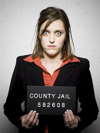 Mug shot of woman in business attire Stock Photo - Premium Royalty-Free, Code: 640-01357124