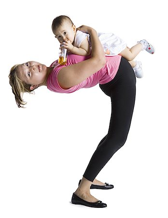 Contortionist mother with baby daughter Stock Photo - Premium Royalty-Free, Code: 640-01357165