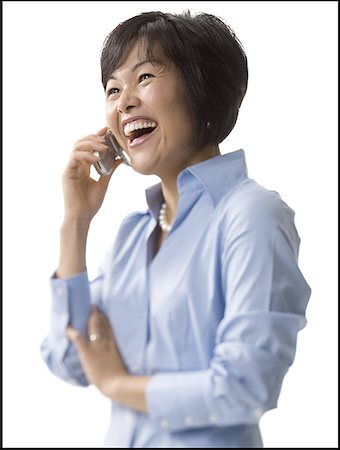 female silhouette head and hand - Close-up of a mid adult woman talking on a mobile phone Stock Photo - Premium Royalty-Free, Code: 640-01357246