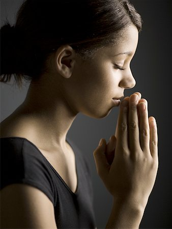 Profile of a girl in a prayer position Stock Photo - Premium Royalty-Free, Code: 640-01357298