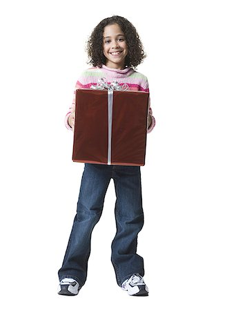 Portrait of a girl holding a gift box Stock Photo - Premium Royalty-Free, Code: 640-01357337