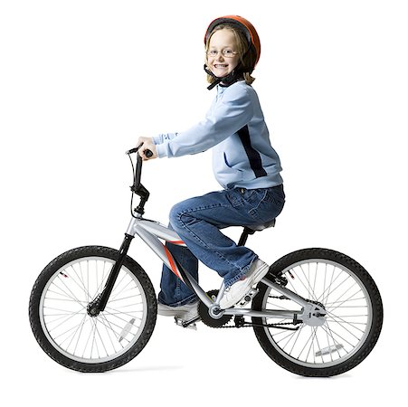 Portrait of a girl riding a bicycle Stock Photo - Premium Royalty-Free, Code: 640-01357343