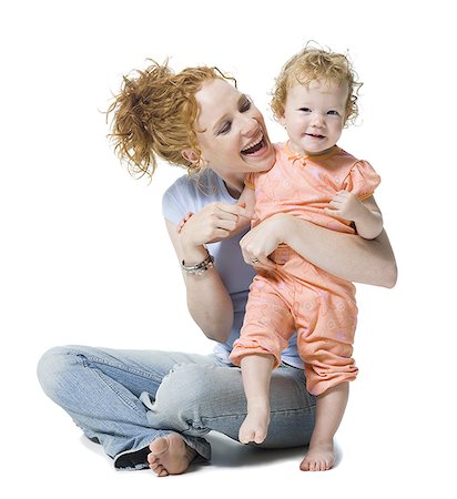 Close-up of a young woman and her daughter smiling Stock Photo - Premium Royalty-Free, Code: 640-01357418