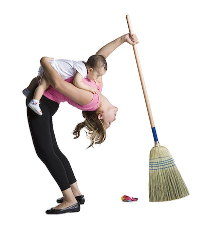 Contortionist mother sweeping while holding baby daughter Stock Photo - Premium Royalty-Free, Code: 640-01357469