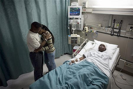 High angle view of parents in a hospital with their son Stock Photo - Premium Royalty-Free, Code: 640-01357583