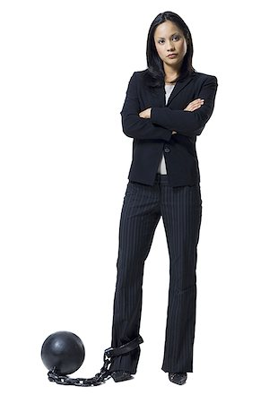 restrained - Businesswoman shackled to ball and chain Stock Photo - Premium Royalty-Free, Code: 640-01357627