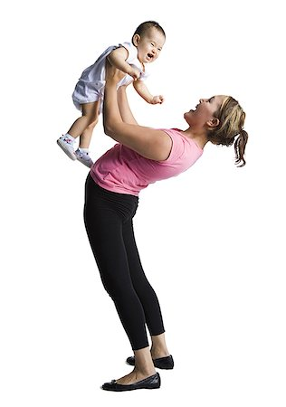 Contortionist mother with baby daughter Stock Photo - Premium Royalty-Free, Code: 640-01357675