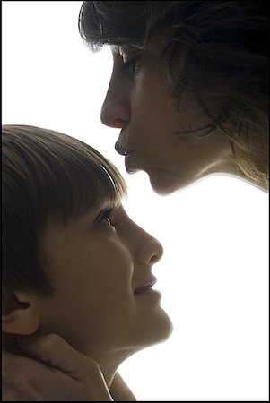 people kissing little boys - Close-up of a mid adult woman kissing her son's forehead Stock Photo - Premium Royalty-Free, Code: 640-01357704
