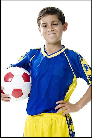 preteen  smile  one  alone - Portrait of a boy holding a soccer ball Stock Photo - Premium Royalty-Free, Code: 640-01357994