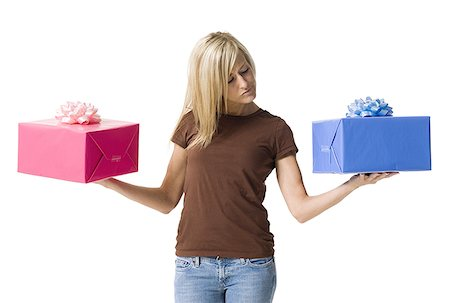 Young woman holding two gifts Stock Photo - Premium Royalty-Free, Code: 640-01358091