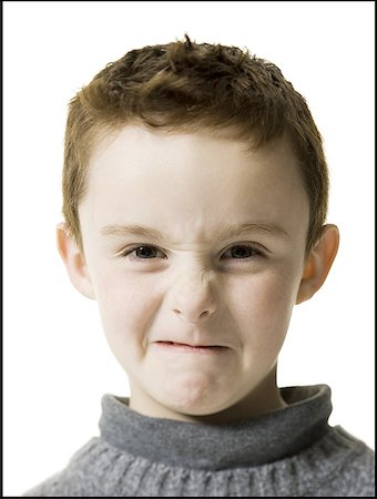 Portrait of a boy making a face Stock Photo - Premium Royalty-Free, Code: 640-01358705