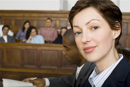 Portrait of a female lawyer smiling Stock Photo - Premium Royalty-Free, Code: 640-01358814