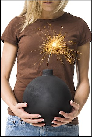 sparks with white background - Mid section view of a young woman holding a bomb Stock Photo - Premium Royalty-Free, Code: 640-01359234