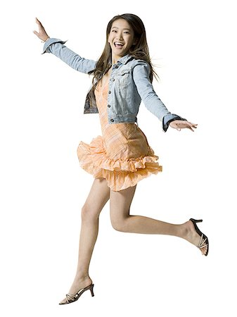 represented - Portrait of a young woman jumping Stock Photo - Premium Royalty-Free, Code: 640-01359527