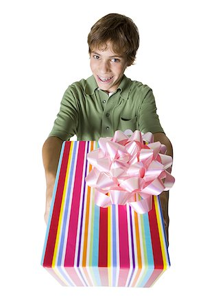 High angle view of a boy giving a gift Stock Photo - Premium Royalty-Free, Code: 640-01359562