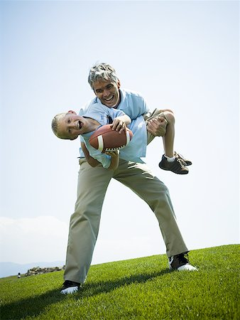 Portrait of a man carrying his son Stock Photo - Premium Royalty-Free, Code: 640-01359623