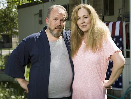 Overweight couple in a trailer park Stock Photo - Premium Royalty-Free, Code: 640-01359778