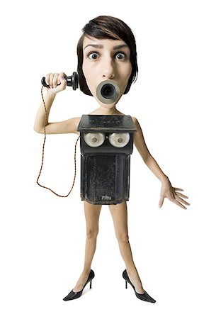 Caricature of a young woman as an old telephone Stock Photo - Premium Royalty-Free, Code: 640-01359828