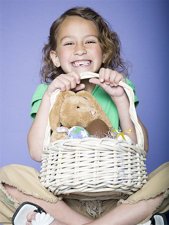 preteen thong - Portrait of a girl holding Easter eggs in a wicker basket Stock Photo - Premium Royalty-Free, Code: 640-01359845