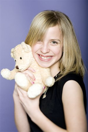 preteen  smile  one  alone - Portrait of a girl holding a teddy bear Stock Photo - Premium Royalty-Free, Code: 640-01359985