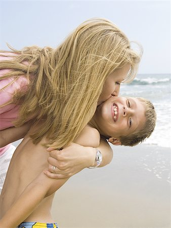 preteen kissing - Woman kissing boy on the beach Stock Photo - Premium Royalty-Free, Code: 640-01359986