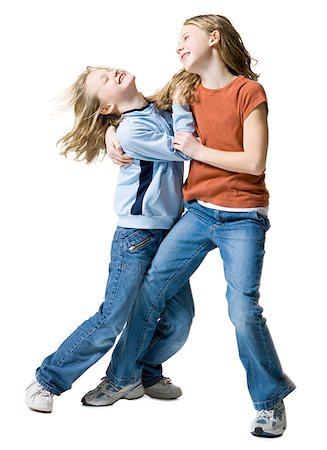 Two sisters playing with each other Stock Photo - Premium Royalty-Free, Code: 640-01350344