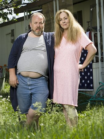 Overweight couple in a trailer park Stock Photo - Premium Royalty-Free, Code: 640-01350499