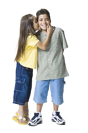 preteen kissing - Profile of a sister kissing her brother Stock Photo - Premium Royalty-Free, Code: 640-01350517