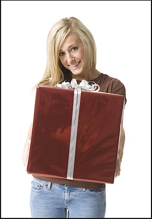 Portrait of a young woman holding a gift Stock Photo - Premium Royalty-Free, Code: 640-01350727