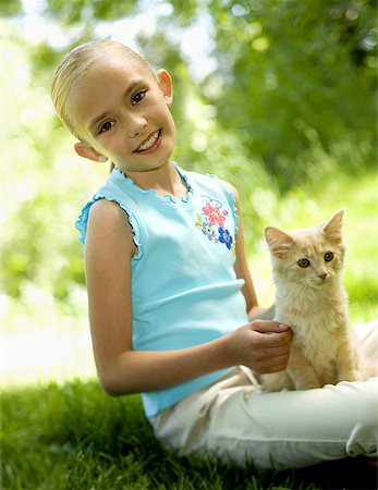 preteen girl pussy - Portrait of a girl sitting with a kitten Stock Photo - Premium Royalty-Free, Code: 640-01350823