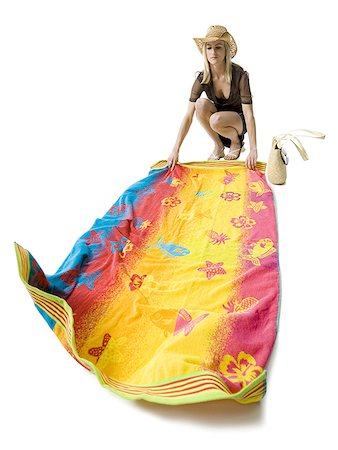 Young woman holding a beach towel Stock Photo - Premium Royalty-Free, Code: 640-01350927