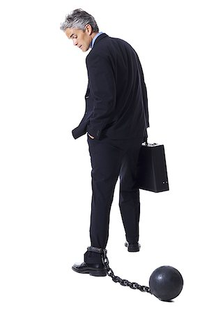 restrained - Businessman shackled to ball and chain Stock Photo - Premium Royalty-Free, Code: 640-01350959