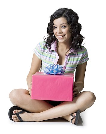Portrait of a teenage girl holding a gift box Stock Photo - Premium Royalty-Free, Code: 640-01351032