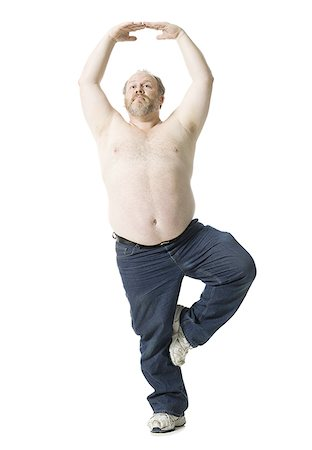 fat man exercising - Close-up of a mature man standing on one leg Stock Photo - Premium Royalty-Free, Code: 640-01351253