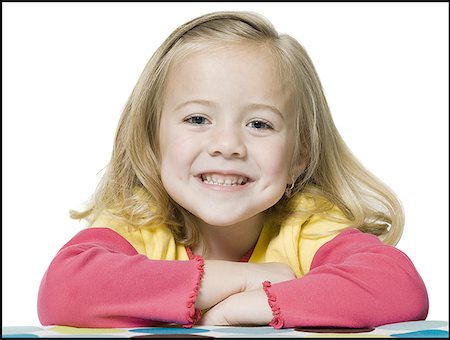 Portrait of a girl smiling Stock Photo - Premium Royalty-Free, Code: 640-01351410