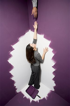 running away scared - High angle view of a mid adult woman reaching out for a man's hand Stock Photo - Premium Royalty-Free, Code: 640-01351455